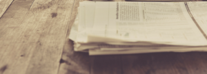 newspaper pages on wooden table