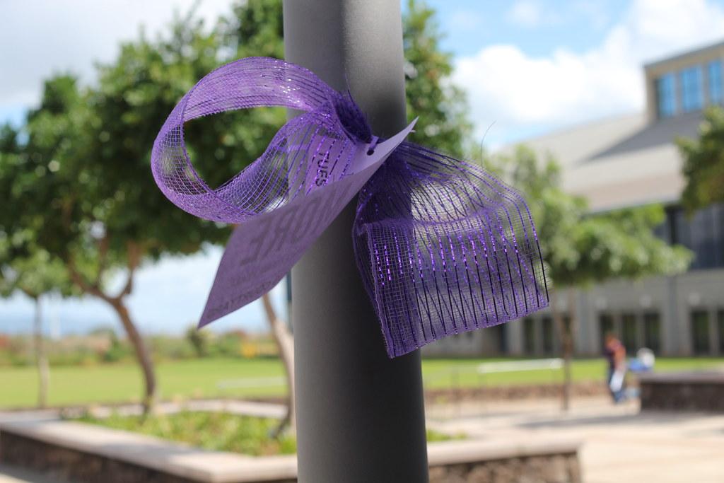 pole with purple ribbon tied around it