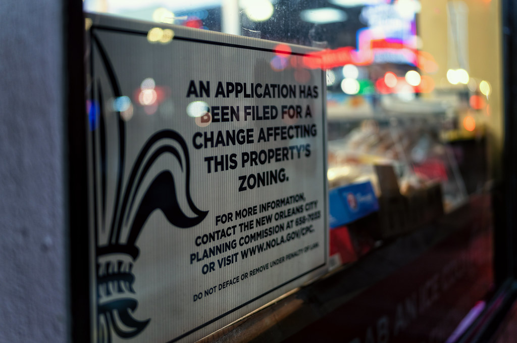 """Sign reading """"An application has been filed for a change affecting this property's zoning"""""""