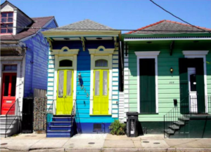 two brightly multi-colored shotgun houses