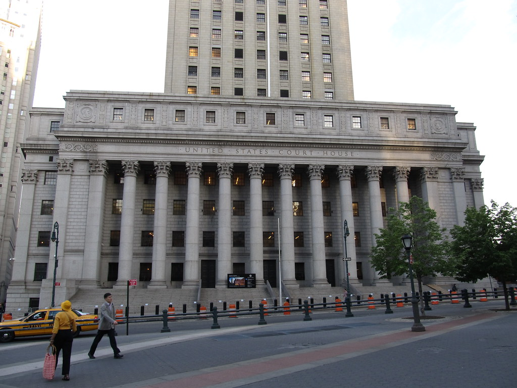 u.s. court house with street and taxi in front