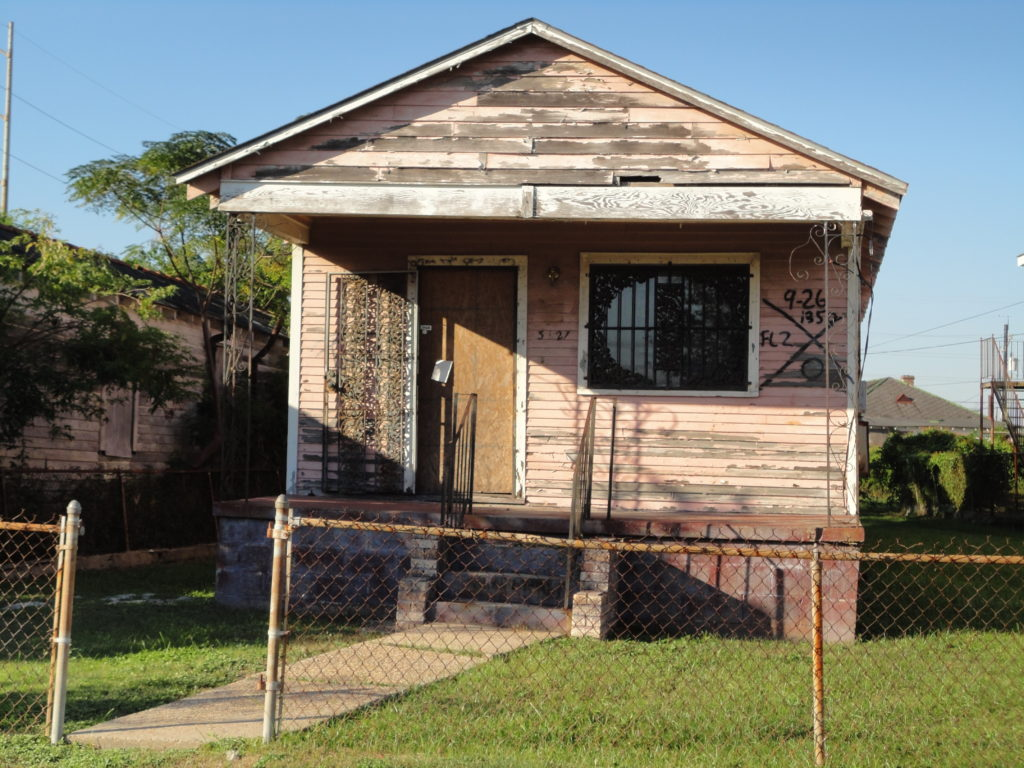 Abandoned home in New Orleans after Katrina, with the well-known code for a searched home