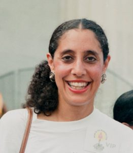 photo of lani guinier smiling with her hair tied back