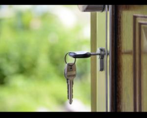 profile of key hanging in door lock