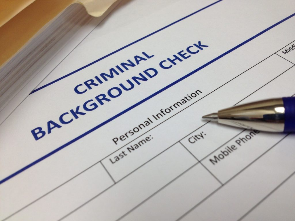 """""""criminal background check"""" paperwork and pen"""