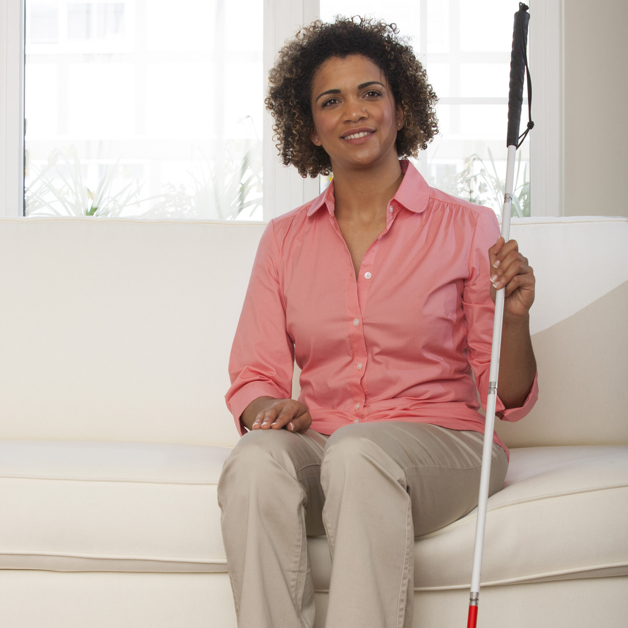 Disabled person at home with walking stick