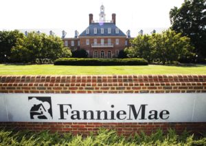 fannie mae headquarters in washington dc, big brick building in the background with large fannie mae sign in the foreground