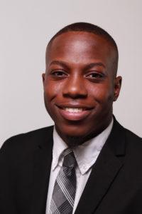 portrait of jaylen thomas in black suit and tie