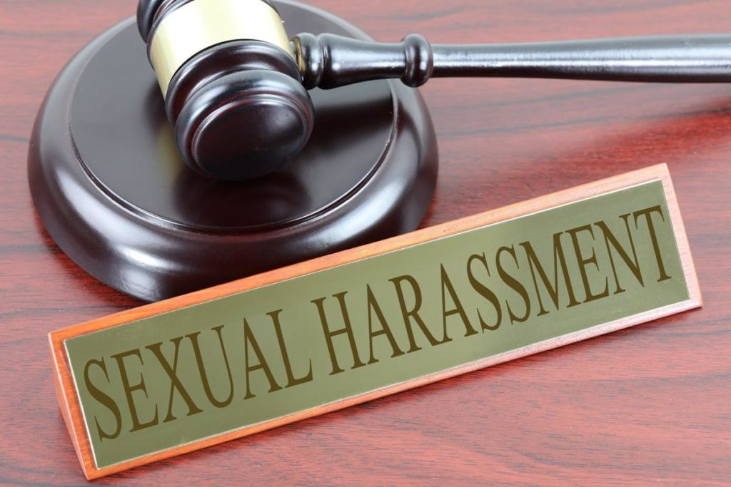 """plaque that says """"sexual harassment"""" in front of gavel"""